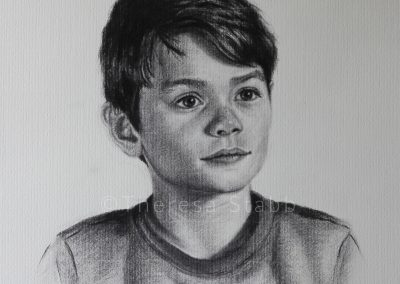 Charcoal portrait of child on paper