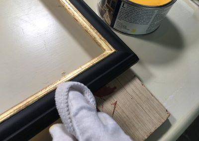 Handmade frames being waxed